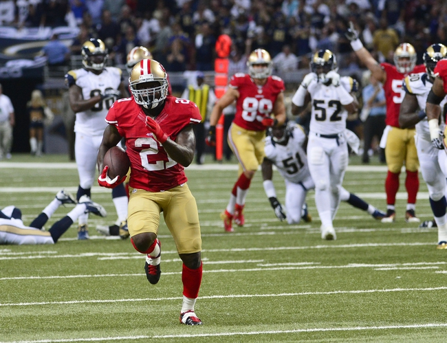 Sep 26, 2013; St. Louis, MO, USA; San Francisco 49ers running back Frank Gore (21) rushes for a 34 yard touchdown run against the St. Louis Rams during the first half at the Edward Jones Dome. Mandatory Credit: Scott Rovak-USA TODAY Sports