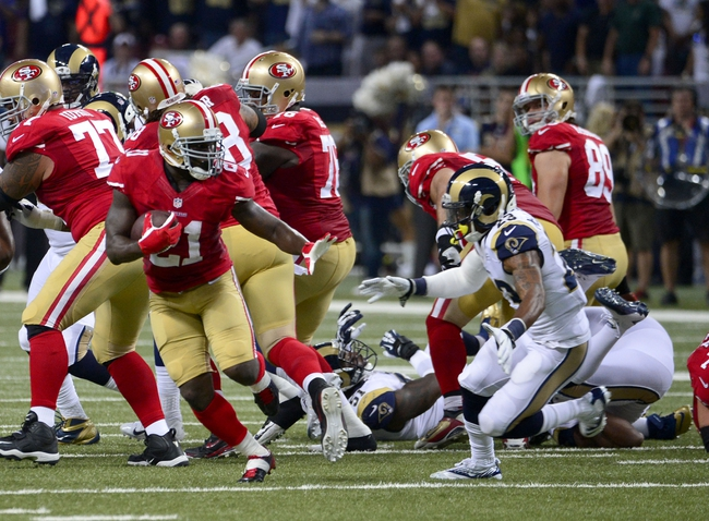 Sep 26, 2013; St. Louis, MO, USA; San Francisco 49ers running back Frank Gore (21) avoids St. Louis Rams free safety Rodney McLeod (23) on the way to a 34 yard touchdown run during the first half at the Edward Jones Dome. Mandatory Credit: Scott Rovak-USA TODAY Sports