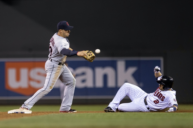 Sep 26, 2013; Minneapolis, MN, USA; Cleveland Indians shortstop Asdrubal Cabrera (13) forces out Minnesota Twins second baseman Brian Dozier (2) at second base and throws the ball to first base to complete a double play in the fifth inning at Target Field. Mandatory Credit: Jesse Johnson-USA TODAY Sports