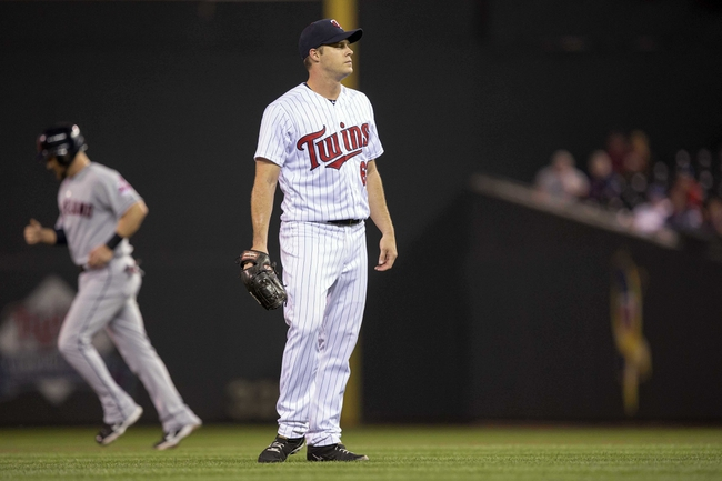 Sep 26, 2013; Minneapolis, MN, USA; Minnesota Twins starting pitcher Andrew Albers (63) looks on after a balk in the fourth against the Cleveland Indians at Target Field. Mandatory Credit: Jesse Johnson-USA TODAY Sports