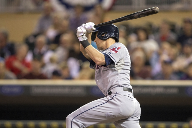 Sep 26, 2013; Minneapolis, MN, USA; Cleveland Indians right fielder Drew Stubbs (11) hits a single in the fourth inning against the Minnesota Twins at Target Field. Mandatory Credit: Jesse Johnson-USA TODAY Sports