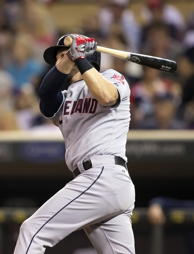 Sep 26, 2013; Minneapolis, MN, USA; Cleveland Indians right fielder Ryan Raburn (9) hits a single in the sixth inning against the Minnesota Twins at Target Field. Mandatory Credit: Jesse Johnson-USA TODAY Sports
