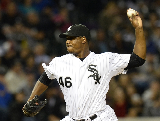 Sep 26, 2013; Chicago, IL, USA; Chicago White Sox relief pitcher Donnie Veal (46) throws a pitch against the Kansas City Royals during the seventh inning at U.S Cellular Field. Kansas City defeats Chicago 3-2. Mandatory Credit: Mike DiNovo-USA TODAY Sports