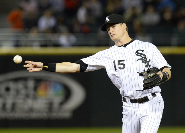 Sep 26, 2013; Chicago, IL, USA; Chicago White Sox second baseman Gordon Beckham (15) makes a throw to first base against the Kansas City Royals during the ninth inning at U.S Cellular Field. Kansas City defeat