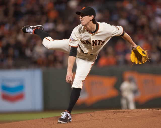 Sep 26, 2013; San Francisco, CA, USA; San Francisco Giants starting pitcher Tim Lincecum (55) pitches against the Los Angeles Dodgers during the first inning at AT&T Park. Mandatory Credit: Ed Szczepanski-USA TODAY Sports