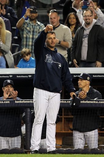 Sep 26, 2013; Bronx, NY, USA; New York Yankees starting pitcher Andy Pettitte (46) takes a curtain call during the ninth inning of his final home game against the Tampa Bay Rays at Yankee Stadium. Mandatory Credit: Brad Penner-USA TODAY Sports