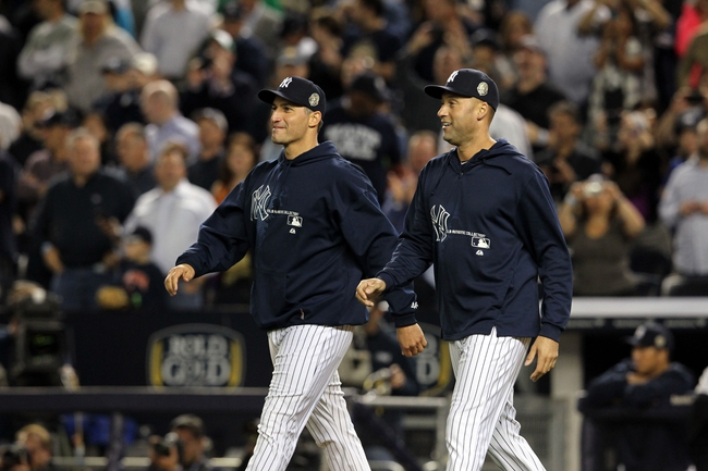 Sep 26, 2013; Bronx, NY, USA; New York Yankees starting pitcher Andy Pettitte (46) and shortstop Derek Jeter (2) walk to the mound to remove relief pitcher Mariano Rivera (not pictured) from his final home game against the Tampa Bay Rays at Yankee Stadium. Mandatory Credit: Brad Penner-USA TODAY Sports