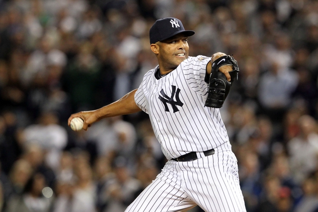 Sep 26, 2013; Bronx, NY, USA; New York Yankees relief pitcher Mariano Rivera (42) pitches during the ninth inning of a game against the Tampa Bay Rays at Yankee Stadium. Mandatory Credit: Brad Penner-USA TODAY Sports