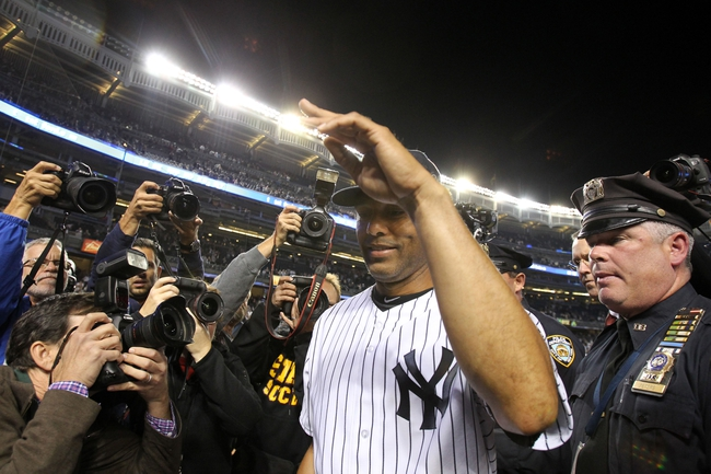 Sep 26, 2013; Bronx, NY, USA; New York Yankees relief pitcher Mariano Rivera (42) salutes the fans as he leaves the field after his final home game against the Tampa Bay Rays at Yankee Stadium. Mandatory Credit: Brad Penner-USA TODAY Sports