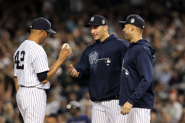 Sep 26, 2013; Bronx, NY, USA; New York Yankees starting pitcher Andy Pettitte (46) and shortstop Derek Jeter (2) walk to the mound to remove relief pitcher Mariano Rivera (42) from his final home game against the Tampa Bay Rays at Yankee Stadium. Mandatory Credit: Brad Penner-USA TODAY Sports