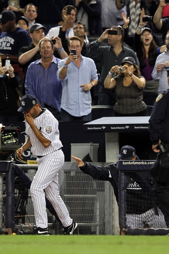 Sep 26, 2013; Bronx, NY, USA; New York Yankees relief pitcher Mariano Rivera (42) is pushed onto the field for a second curtain call after being removed from his final home game against the Tampa Bay Rays at Yankee Stadium. Mandatory Credit: Brad Penner-USA TODAY Sports