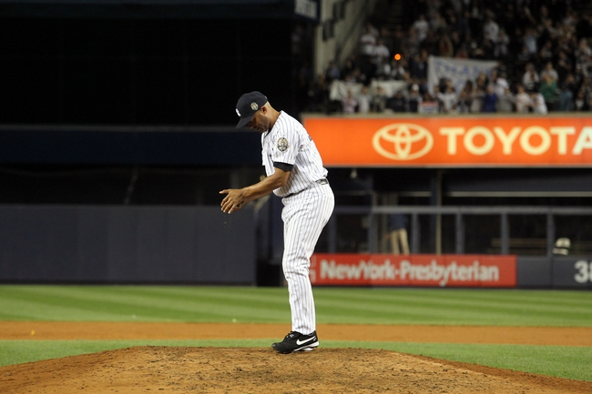 Sep 26, 2013; Bronx, NY, USA; New York Yankees relief pitcher Mariano Rivera (42) collects some dirt from the mound after his final home game against the Tampa Bay Rays at Yankee Stadium. Mandatory Credit: Brad Penner-USA TODAY Sports