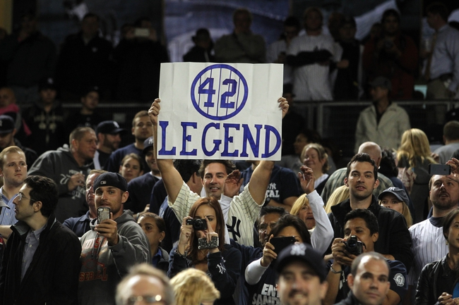 Sep 26, 2013; Bronx, NY, USA; Fans hold up a sign honoring New York Yankees relief pitcher Mariano Rivera (not pictured) after a game against the Tampa Bay Rays at Yankee Stadium. Mandatory Credit: Brad Penner-USA TODAY Sports