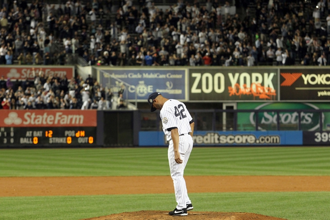 Sep 26, 2013; Bronx, NY, USA; New York Yankees relief pitcher Mariano Rivera (42) walks to the mound to collect some dirt after his final home game against the Tampa Bay Rays at Yankee Stadium. Mandatory Credit: Brad Penner-USA TODAY Sports