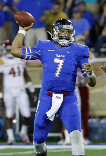 Sep 26, 2013; Tulsa, OK, USA; Tulsa Golden Hurricane quarterback Cody Green (7) throws a pass during the second half against the Iowa State Cyclones at Skelly Field at H.A. Chapman Stadium. Mandatory Credit: Alonzo Adams-USA TODAY Sports