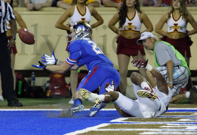 Sep 26, 2013; Tulsa, OK, USA; Tulsa Golden Hurricane wide receiver Thomas Roberson (left) catches a throw for a touchdown during the second half against the Iowa State Cyclones at Skelly Field at H.A. Chapman Stadium. Mandatory Credit: Alonzo Adams-USA TODAY Sports