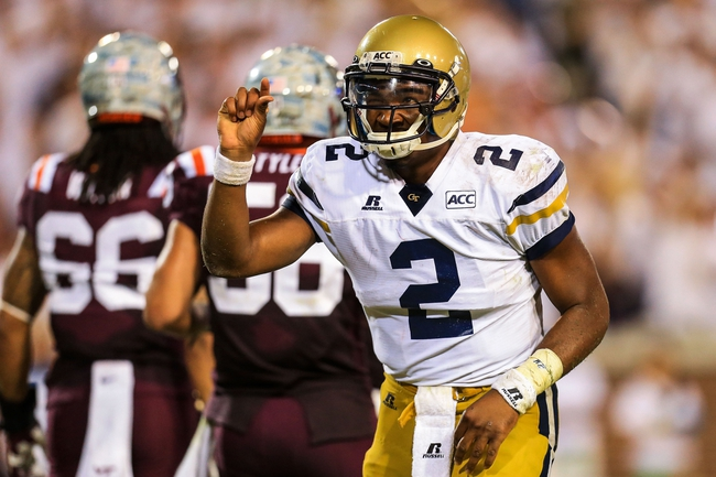 Sep 26, 2013; Atlanta, GA, USA; Georgia Tech Yellow Jackets quarterback Vad Lee (2) reacts to the crowd after coming close to a touchdown in the second half against the Virginia Tech Hokies at Bobby Dodd Stadium. Virginia Tech won 17-10. Mandatory Credit: Daniel Shirey-USA TODAY Sports