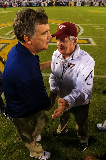 Sep 26, 2013; Atlanta, GA, USA; Georgia Tech Yellow Jackets head coach Paul Johnson and Virginia Tech Hokies head coach Frank Beamer shake hands after the game at Bobby Dodd Stadium. Virginia Tech won 17-10. Mandatory Credit: Daniel Shirey-USA TODAY Sports