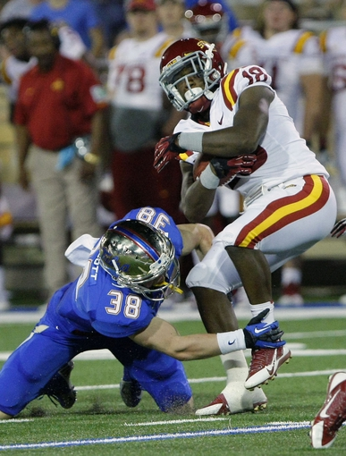 Sep 26, 2013; Tulsa, OK, USA; Tulsa Golden Hurricane Matt Linscott (38) tackles Iowa State Cyclones Albert Gary (18) during the second half at Skelly Field at H.A. Chapman Stadium. Mandatory Credit: Alonzo Adams-USA TODAY Sports