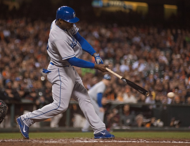 Sep 26, 2013; San Francisco, CA, USA; Los Angeles Dodgers right fielder Yasiel Puig (66) hits a single against the San Francisco Giants during the second inning at AT&T Park. Mandatory Credit: Ed Szczepanski-USA TODAY Sports