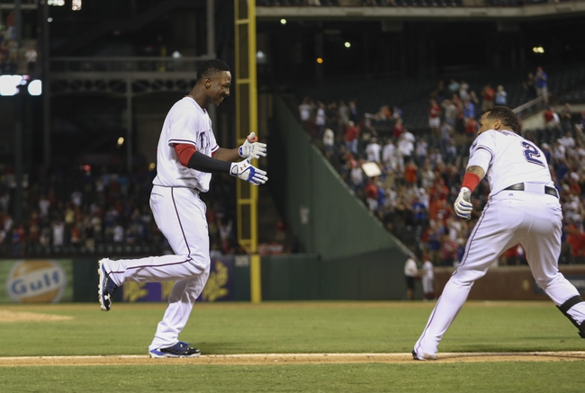 Sep 26, 2013; Arlington, TX, USA; Texas Rangers second baseman Jurickson Profar (13) hits a walk off home run and is greeted by center fielder Leonys Martin (2) on his way to home plate during the ninth inning against the Los Angeles Angels at Rangers Ballpark in Arlington. Mandatory Credit: Kevin Jairaj-USA TODAY Sports