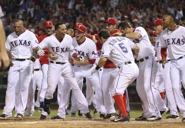 Sep 26, 2013; Arlington, TX, USA; Texas Rangers palyers celebrate the walk off home run hit by Texas Rangers second baseman Jurickson Profar (not pictured) during the ninth inning against the Los Angeles Angels at Rangers Ballpark in Arlington. Mandatory Credit: Kevin Jairaj-USA TODAY Sports