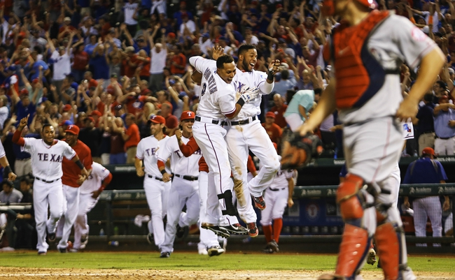 Sep 26, 2013; Arlington, TX, USA; Texas Rangers shortstop Elvis Andrus (right) and center fielder Leonys Martin (2) celebrate the walk off home run hit by Texas Rangers second baseman Jurickson Profar (not pictured) during the ninth inning against the Los Angeles Angels at Rangers Ballpark in Arlington. Mandatory Credit: Kevin Jairaj-USA TODAY Sports