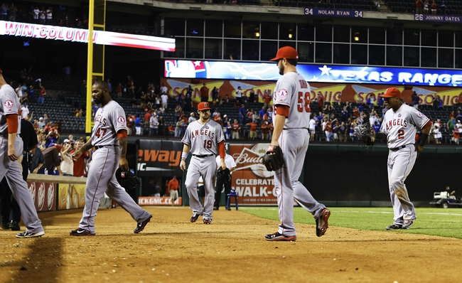 Sep 26, 2013; Arlington, TX, USA; Los Angeles Angels players walk off the field after losing to the Texas Rangers at Rangers Ballpark in Arlington. Mandatory Credit: Kevin Jairaj-USA TODAY Sports