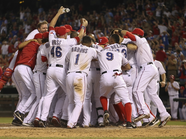 Sep 26, 2013; Arlington, TX, USA; Texas Rangers second baseman Jurickson Profar (not pictured) hits a walk off home run and is greeted by teammates at home plate during the ninth inning against the Los Angeles Angels at Rangers Ballpark in Arlington. Mandatory Credit: Kevin Jairaj-USA TODAY Sports