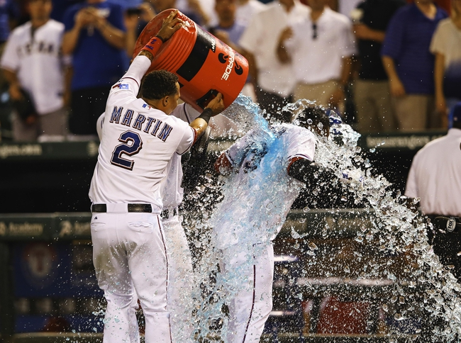 Sep 26, 2013; Arlington, TX, USA; Texas Rangers second baseman Jurickson Profar (right) gets a gatorade bath by  center fielder Leonys Martin (2) after hitting a walk off home run during the ninth inning against the Los Angeles Angels at Rangers Ballpark in Arlington. Mandatory Credit: Kevin Jairaj-USA TODAY Sports