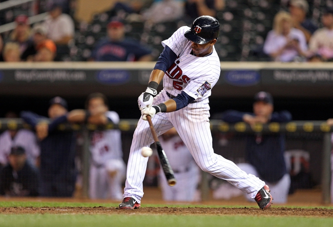 Sep 26, 2013; Minneapolis, MN, USA; Minnesota Twins shortstop Eduardo Escobar (5) hits a single in the ninth inning against the Cleveland Indians at Target Field. The Indians won 6-5. Mandatory Credit: Jesse Johnson-USA TODAY Sports