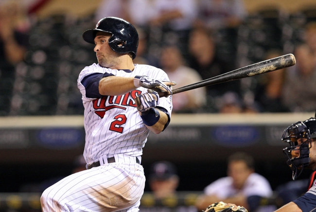 Sep 26, 2013; Minneapolis, MN, USA; Minnesota Twins second baseman Brian Dozier (2) hits a RBI fielders choice in the ninth inning against the Cleveland Indians at Target Field. The Indians won 6-5. Mandatory Credit: Jesse Johnson-USA TODAY Sports