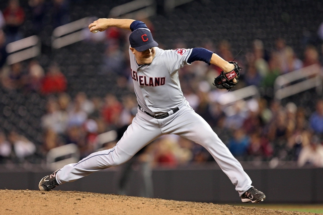 Sep 26, 2013; Minneapolis, MN, USA; Cleveland Indians relief pitcher Joe Smith (38) delivers a pitch in the ninth inning against the Minnesota Twins at Target Field. The Indians won 6-5. Mandatory Credit: Jesse Johnson-USA TODAY Sports
