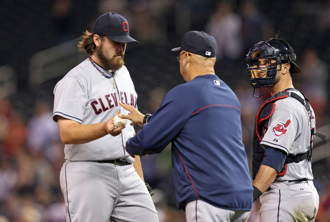 Sep 26, 2013; Minneapolis, MN, USA; Cleveland Indians relief pitcher Chris Perez (54) gets pulled from the game by Cleveland Indians manager Terry Francona in the ninth inning against the Minnesota Twins at Target Field. The Indians won 6-5. Mandatory Credit: Jesse Johnson-USA TODAY Sports