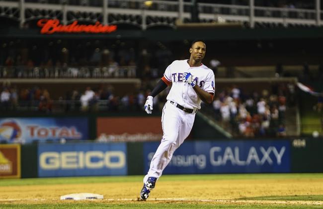 Sep 26, 2013; Arlington, TX, USA; Texas Rangers second baseman Jurickson Profar (13) rounds third base after hitting a walk off home run during the ninth inning against the Los Angeles Angels at Rangers Ballpark in Arlington. Mandatory Credit: Kevin Jairaj-USA TODAY Sports