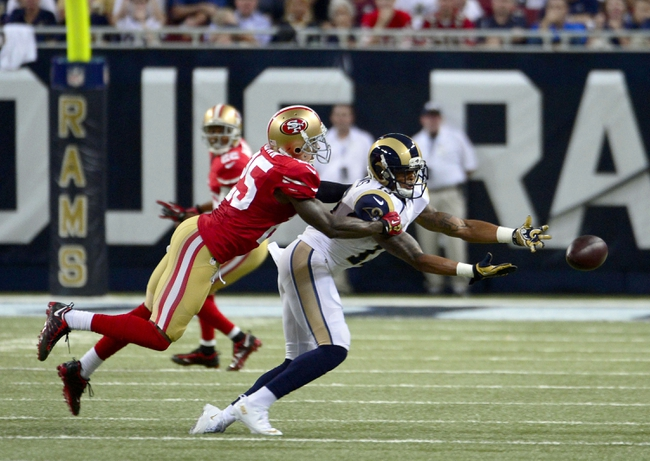 Sep 26, 2013; St. Louis, MO, USA; St. Louis Rams wide receiver Chris Givens (13) attempts to reach for a pass as San Francisco 49ers cornerback Tarell Brown (25) defends during the second half at the Edward Jones Dome. The 49ers defeated the Rams 35-11. Mandatory Credit: Scott Rovak-USA TODAY Sports