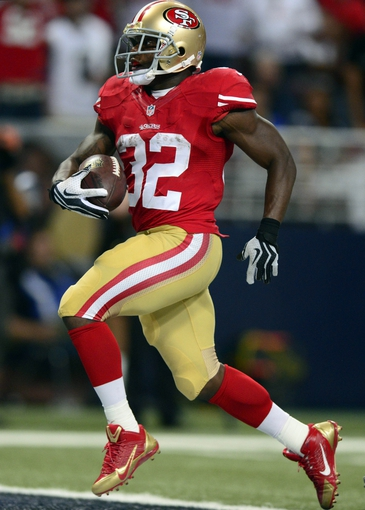 Sep 26, 2013; St. Louis, MO, USA; San Francisco 49ers running back Kendall Hunter (32) rushes for a 29 yard touchdown against the St. Louis Rams during the second half at the Edward Jones Dome. San Francisco defeated St. Louis 35-11. Mandatory Credit: Jeff Curry-USA TODAY Sports