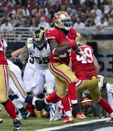 Sep 26, 2013; St. Louis, MO, USA; San Francisco 49ers running back Anthony Dixon (24) scores a touchdown against the St. Louis Rams during the second half at the Edward Jones Dome. The 49ers defeated the Rams 35-11. Mandatory Credit: Scott Rovak-USA TODAY Sports