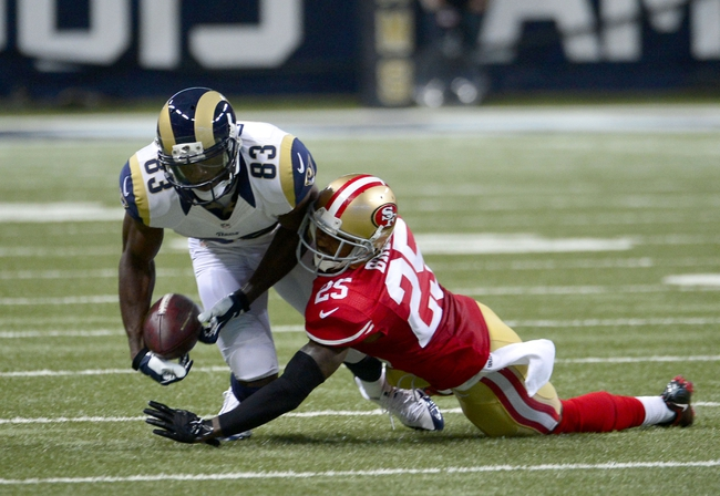 Sep 26, 2013; St. Louis, MO, USA; St. Louis Rams strong safety T.J. McDonald (25) deflects the ball away from St. Louis Rams wide receiver Brian Quick (83) during the second half at the Edward Jones Dome. The 49ers defeated the Rams 35-11. Mandatory Credit: Scott Rovak-USA TODAY Sports