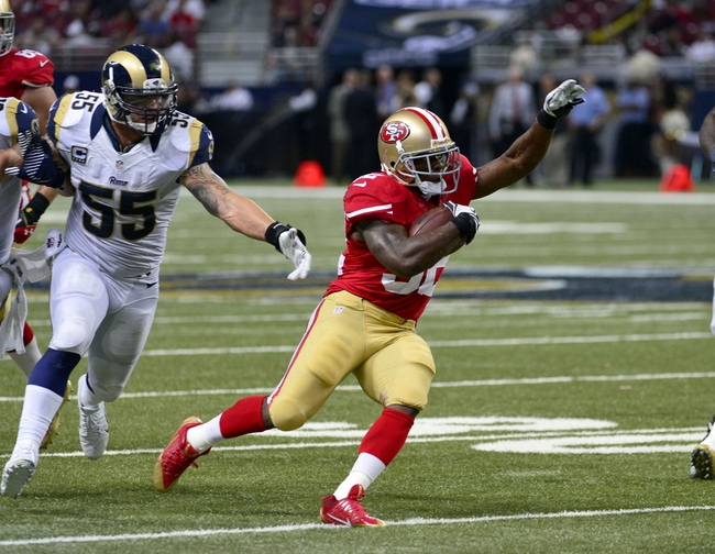 Sep 26, 2013; St. Louis, MO, USA; San Francisco 49ers running back Kendall Hunter (32) breaks away from St. Louis Rams middle linebacker James Laurinaitis (55) on the way to a 29 yard touchdown during the second half at the Edward Jones Dome. The 49ers defeated the Rams 35-11. Mandatory Credit: Scott Rovak-USA TODAY Sports