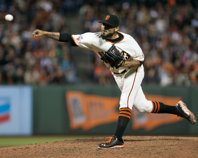 Sep 26, 2013; San Francisco, CA, USA; San Francisco Giants relief pitcher Sergio Romo (54) pitches against the Los Angeles Dodgers during the ninth inning at AT&T Park. The San Francisco Giants defeated the Los Angeles Dodgers 3-2. Mandatory Credit: Ed Szczepanski-USA TODAY Sports