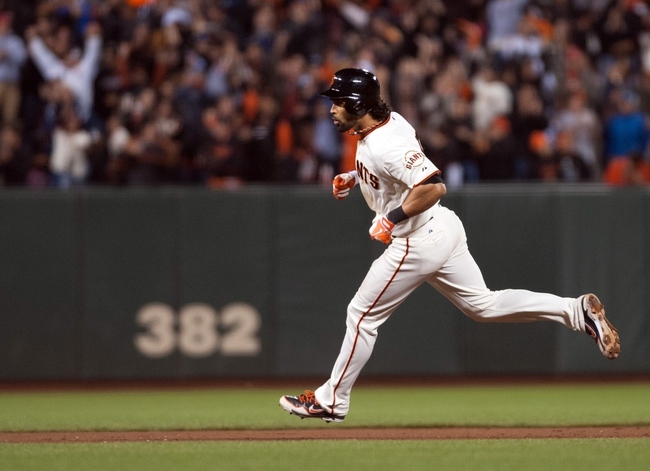 Sep 26, 2013; San Francisco, CA, USA; San Francisco Giants center fielder Angel Pagan (16) rounds the bases after hitting a home run during the eighth inning against the Los Angeles Dodgers at AT&T Park. The San Francisco Giants defeated the Los Angeles Dodgers 3-2. Mandatory Credit: Ed Szczepanski-USA TODAY Sports