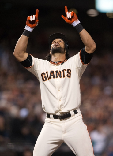 Sep 26, 2013; San Francisco, CA, USA; San Francisco Giants center fielder Angel Pagan (16) points to the sky after hitting a home run during the eighth inning against the Los Angeles Dodgers at AT&T Park. The San Francisco Giants defeated the Los Angeles Dodgers 3-2. Mandatory Credit: Ed Szczepanski-USA TODAY Sports
