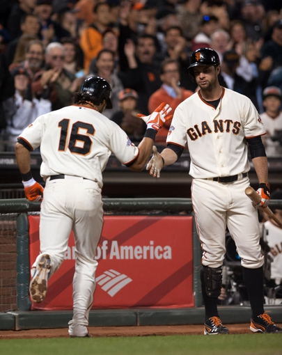 Sep 26, 2013; San Francisco, CA, USA; San Francisco Giants center fielder Angel Pagan (16) is congratulated by first baseman Brandon Belt (9) after hitting a home run during the eighth inning against the Los Angeles Dodgers at AT&T Park. The San Francisco Giants defeated the Los Angeles Dodgers 3-2. Mandatory Credit: Ed Szczepanski-USA TODAY Sports