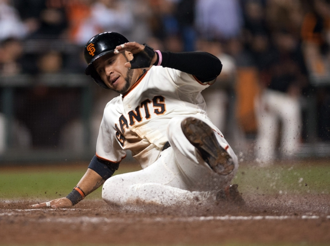 Sep 26, 2013; San Francisco, CA, USA; San Francisco Giants center fielder Gregor Blanco (7) slides into home against the Los Angeles Dodgers during the fifth inning at AT&T Park. The San Francisco Giants defeated the Los Angeles Dodgers 3-2. Mandatory Credit: Ed Szczepanski-USA TODAY Sports