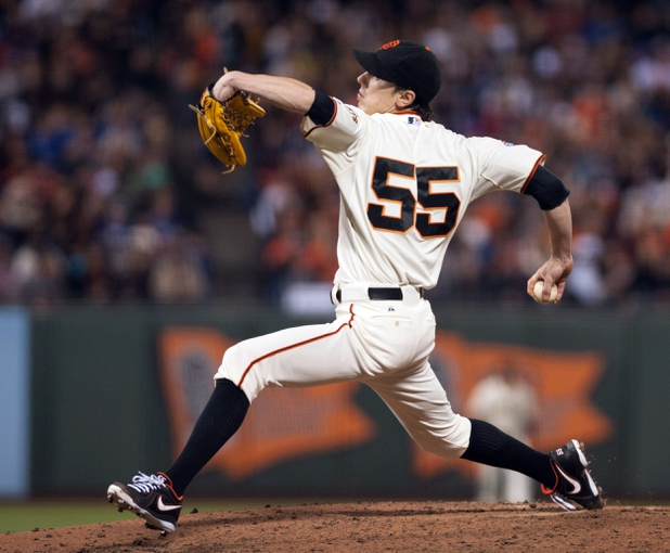 Sep 26, 2013; San Francisco, CA, USA; San Francisco Giants starting pitcher Tim Lincecum (55) pitches against the Los Angeles Dodgers during the fourth inning at AT&T Park. The San Francisco Giants defeated the Los Angeles Dodgers 3-2. Mandatory Credit: Ed Szczepanski-USA TODAY Sports