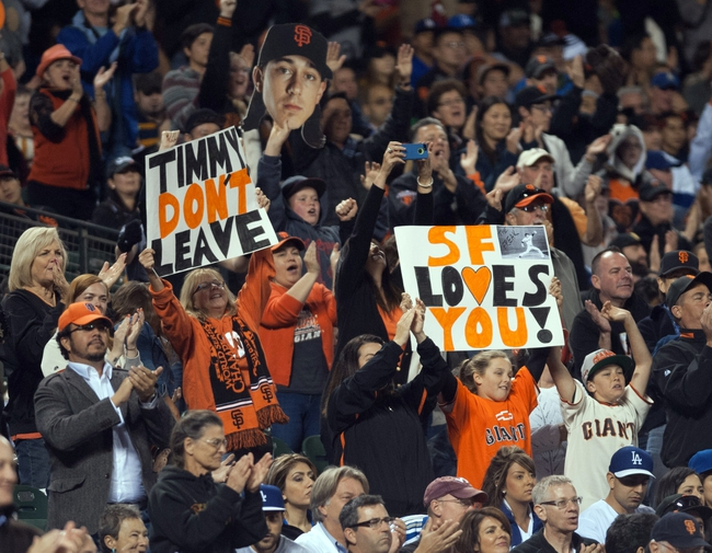 Sep 26, 2013; San Francisco, CA, USA; San Francisco Giants fans hold up signs starting pitcher Tim Lincecum during the fifth inning of the game against the Los Angeles Dodgers at AT&T Park. The San Francisco Giants defeated the Los Angeles Dodgers 3-2. Mandatory Credit: Ed Szczepanski-USA TODAY Sports