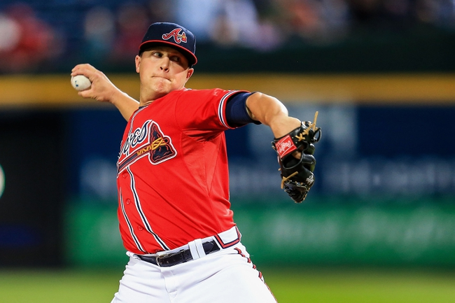 Sep 27, 2013; Atlanta, GA, USA; Atlanta Braves starting pitcher Kris Medlen (54) pitches in the first inning against the Philadelphia Phillies at Turner Field. Mandatory Credit: Daniel Shirey-USA TODAY Sports