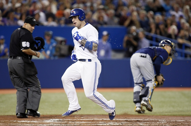 Sep 27, 2013; Toronto, Ontario, CAN; Toronto Blue Jays third baseman Brett Lawrie (13) scores a run in the in the fourth inning against the Tampa Bay Rays at Rogers Centre. Mandatory Credit: John E. Sokolowski-USA TODAY Sports