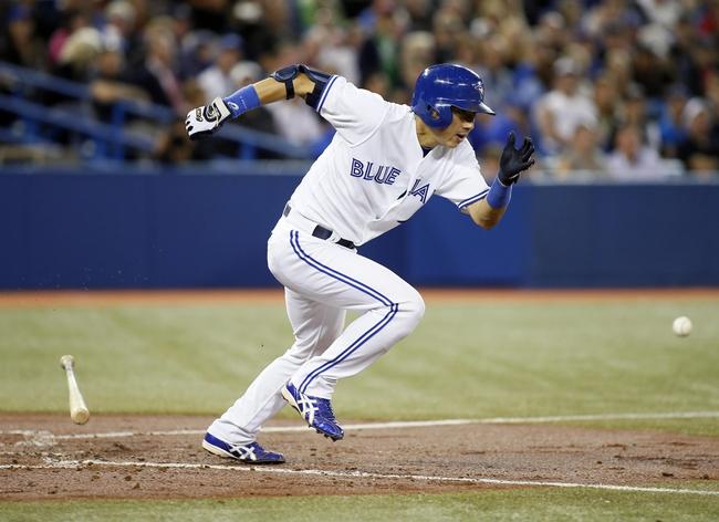 Sep 27, 2013; Toronto, Ontario, CAN; Toronto Blue Jays second baseman Munenori Kawasaki (66) bunts against the Tampa Bay Rays in the fourth inning at Rogers Centre. Mandatory Credit: John E. Sokolowski-USA TODAY Sports